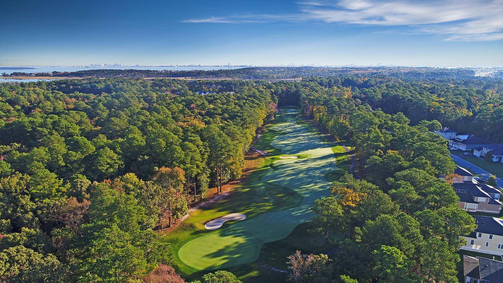 Aerial view of golf course in the middle of trees